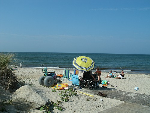 Wheelchairs on an accessible beach on Cape Cod Bay