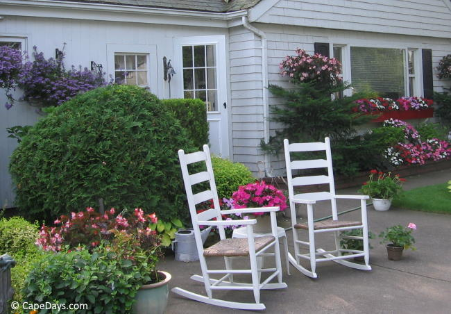 Rocking chairs on patio at a Cape Cod vacation rental