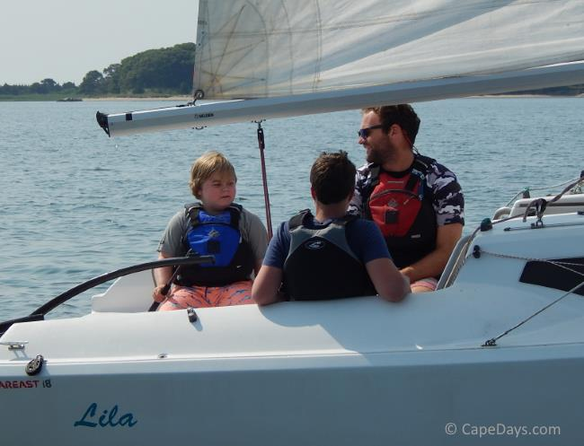 Sailor and instructors on sailboat on the water