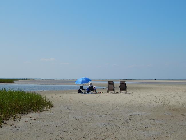 People relaxing at Rock Harbor Beach