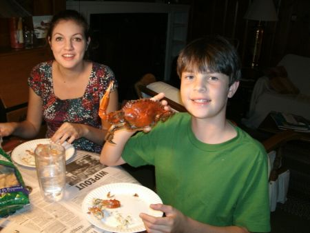 Family around the table enjoying a crab feast