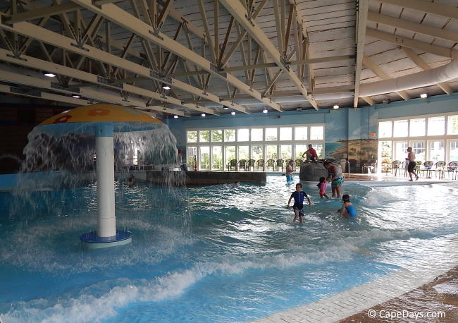 Children playing in wave pool