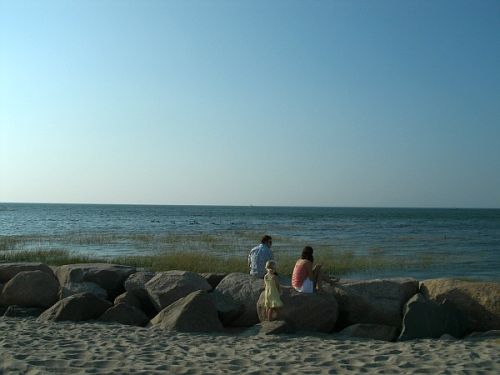 A young family enjoying an early evening visit to Paine's Creek Beach in Brewster MA