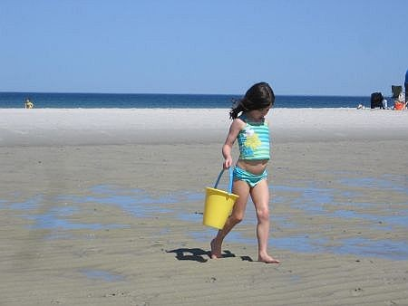 young girl on a cape cod bay beach