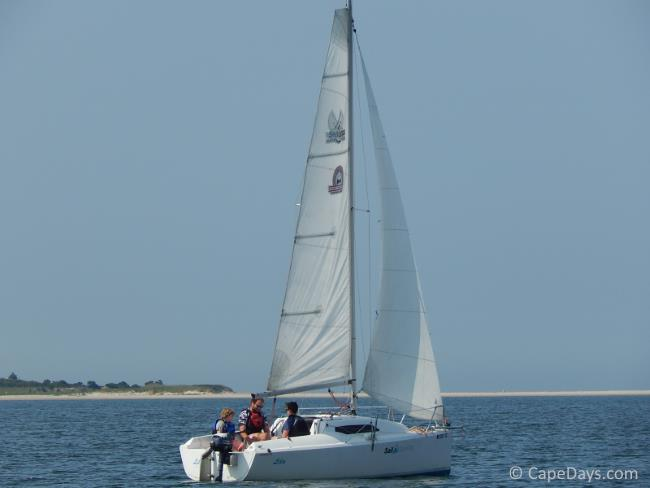 Sailboat and sailors on the water