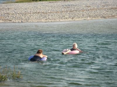 Ladies having a leisurely float at Paine's Creek Beach in Brewster MA
