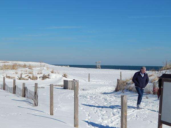 Man walking on Seagull Beach in February