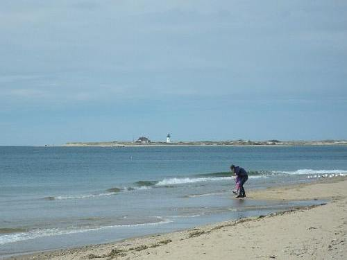 Lighthouse in the distance from Herring Cove Beach