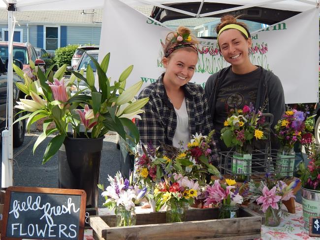 Ladies selling fresh flowers at Hyannis MA farmers market