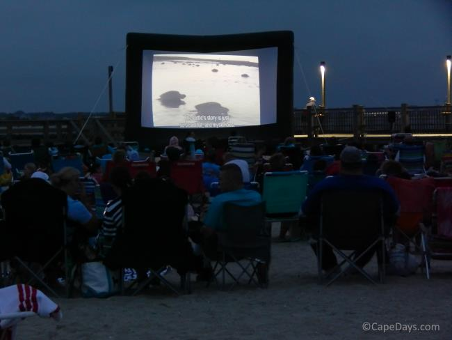 Beachgoers waiting for the feature film to begin