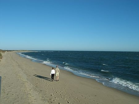 couple walking on south cape beach