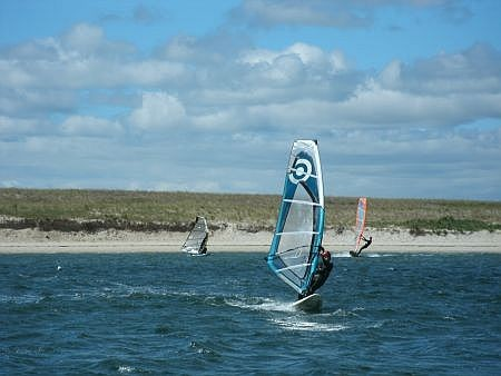 man windsurfing near kalmus beach