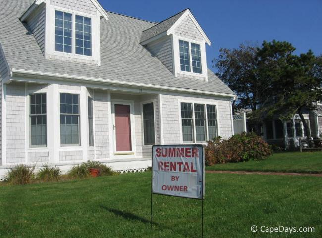 summer rental home with sign